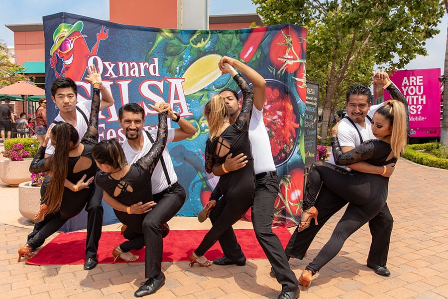 'Oxnard Salsa Festival' Group Posing by Backdrop