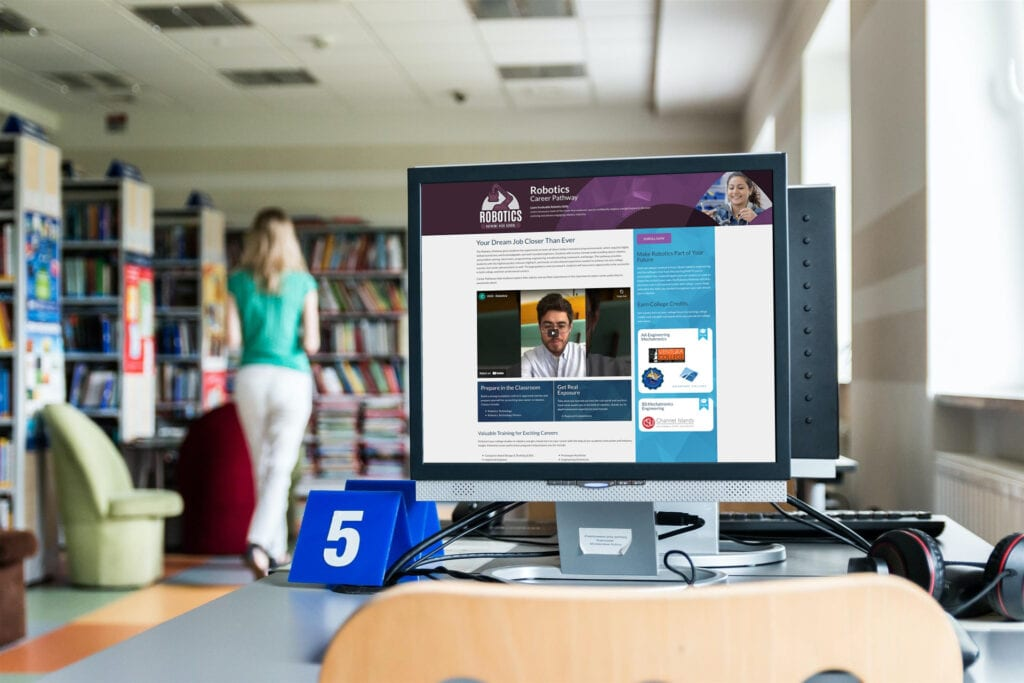 A library computer displays a Robotics Career Pathway page from the OUHSD website
