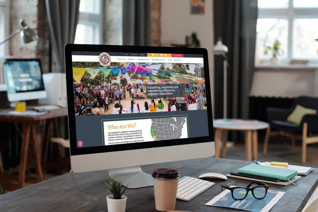 The Mixteco website is displayed on an iMac in a home setting
